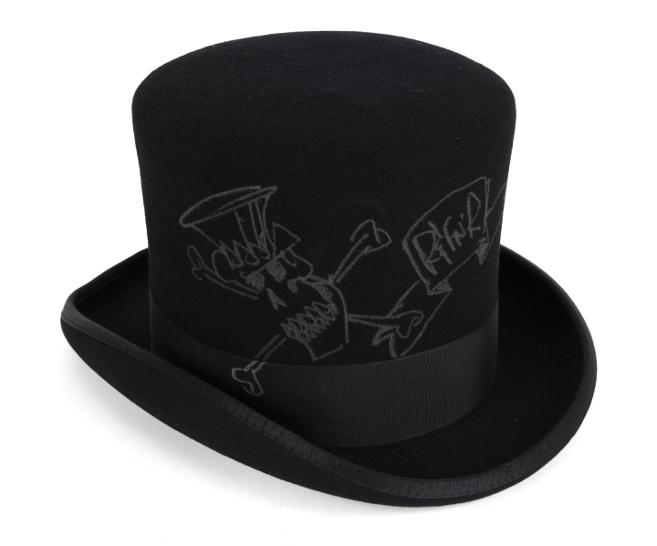 This photo provided by Julien's Auctions shows a signed top hat that belongs to Guns N' Roses guitarist Slash. The former wife of Slash is selling off exotic and erotic items, including the signed top hat, from their 14 years of marriage. Julien's Auctions on Thursday, April 3, 2019, announced the collection from Slash and Perla Hudson's Beverly Hills estate will be part of next month's Music Icons auction. (Julien's Auctions via AP)