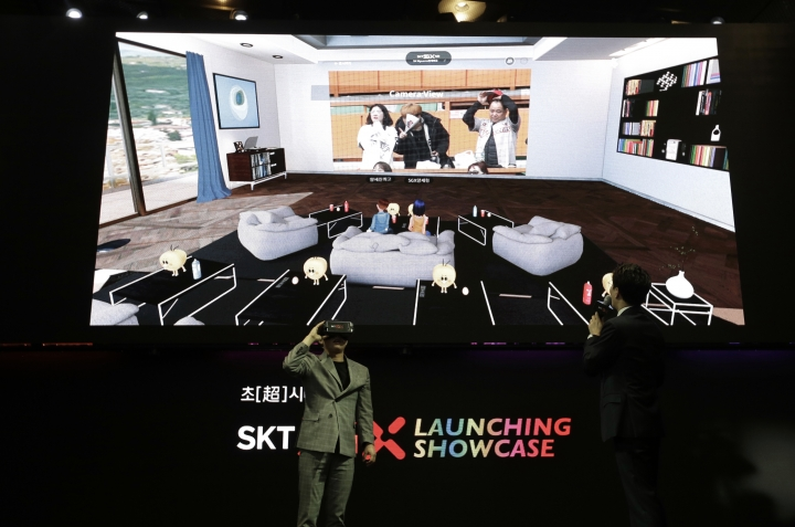 South Korean Comedian Yang Se-hyun wears a VR device for an audio-visual experience during a media showcase for 5G service of SK Telecom in Seoul, South Korea, Wednesday, April 3, 2019. SK Telecom will be launching commercial 5G services nationwide on Friday, April 5, in line with its competitors. (AP Photo/Ahn Young-joon)