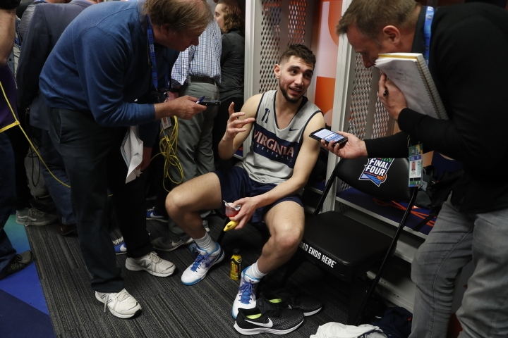 Virginia's Ty Jerome answers questions after a practice session for the semifinals of the Final Four NCAA college basketball tournament, Thursday, April 4, 2019, in Minneapolis. (AP Photo/Jeff Roberson)