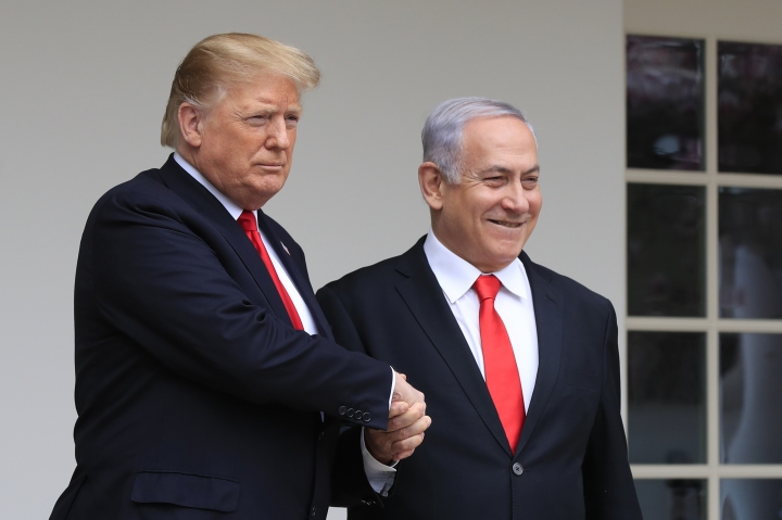 FILE - In this Monday, March 25, 2019 file photo, President Donald Trump welcomes visiting Israeli Prime Minister Benjamin Netanyahu to the White House in Washington. In a tight race for re-election, Israel's prime minister has gotten a welcome lift from his friend in the White House. In the run-up to the April 9 vote, Netanyahu has hosted Secretary of State Mike Pompeo, visited Trump in the White House and received American recognition of Israeli sovereignty over the Golan Heights, which Israel seized from Syria during the 1967 Mideast war. (AP Photo/Manuel Balce Ceneta, File)