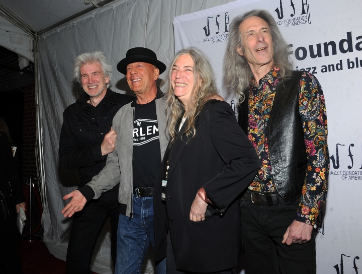"Tony Shanahan, from left, Bruce Willis, Patti Smith, and Lenny Kaye walk the red carpet at the Jazz Foundation of America's 17th annual ""A Great Night In Harlem"" gala concert at the Apollo Theater on Thursday, April 4, 2019, in New York. (Photo by Brad Barket/Invision/AP)"