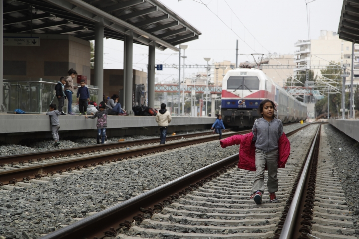A migrant boy walks on the tracks at Larissis rail way central station in Athens, Friday, April 5, 2019. Protesting migrants in Greece have blocked Athens' main train station and disrupted rail services, apparently prompted by false reports on social media that restrictions on travel to northern Europe had been lifted. (AP Photo/Thanassis Stavrakis)