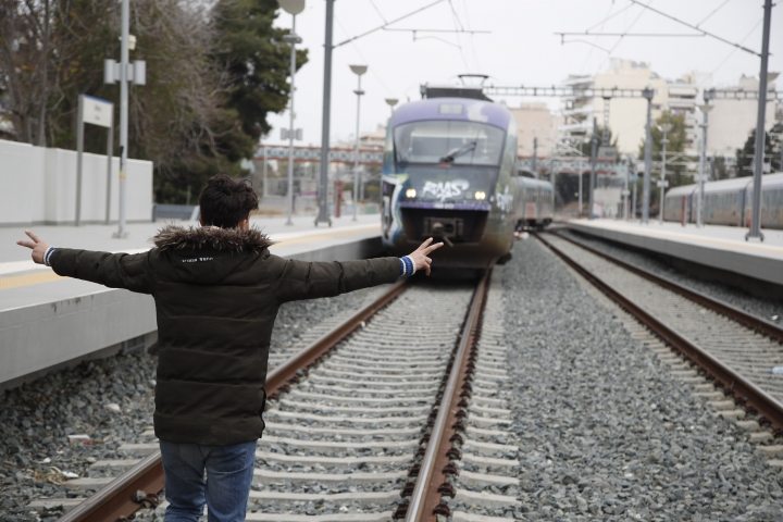A migrant reacts as walks at the rail way that blocked from migrants at the Larissis rail way central station in Athens, Friday, April 5, 2019. Yesterday In the wake of anonymous calls on social media for a long trek through heavily guarded Balkan borders, police said more than 500 people, including families with small children, assembled in a cornfield outside the Diavata migrant camp, which is around 10 kilometers (6 miles) west of the city of Thessaloniki. (AP Photo/Thanassis Stavrakis)