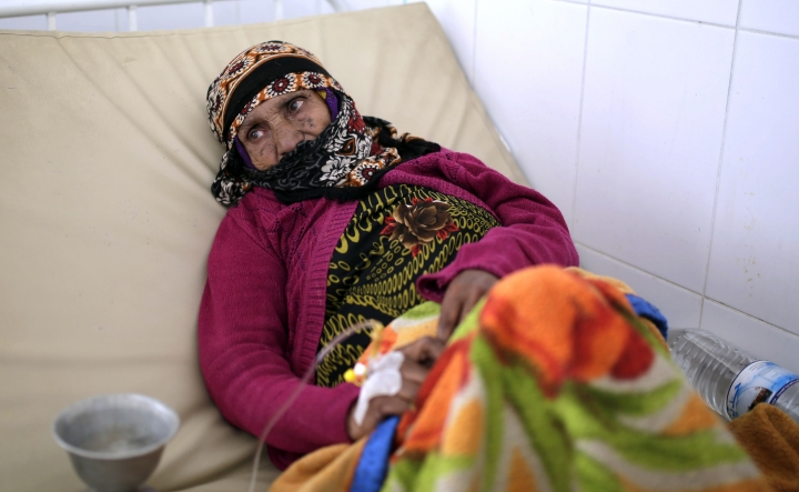 FILE - In this Thursday, March 28, 2019 file photo, an elderly woman is treated for suspected cholera infection at a hospital in Sanaa, Yemen. Cholera is surging once more in Yemen, with more than 76,000 suspected new cases and 195 deaths in March, double the number in the previous two months, according to U.N. figures. Doctors point to the difficulty in controlling epidemics in a country where infrastructure has been decimated by four years of war. (AP Photo/Hani Mohammed, File)