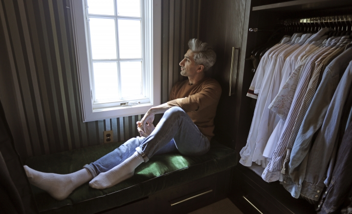 "In this March 15, 2019, photo, Tan France, a cast member on the Netflix series ""Queer Eye,"" looks out of the window in the attic of his home in Salt Lake City. His series touches on some of the country's deepest divides with persistent optimism. The makeover program starring five gay men tackles the contrast between urban and rural, white and black, liberal and conservative. (AP Photo/Rick Bowmer)"