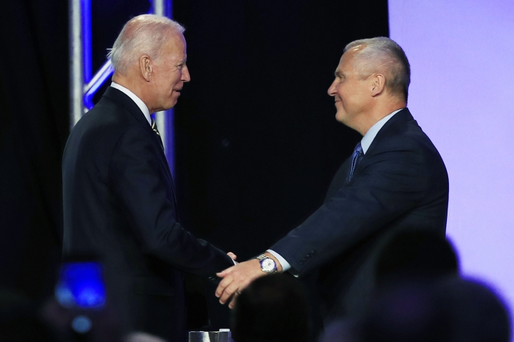 Former Vice President Joe Biden is greeted by International Brotherhood of Electrical Workers President Lonnie Stephenson as he arrives to speak at IBEW's construction and maintenance conference in Washington, Friday, April 5, 2019. (AP Photo/Manuel Balce Ceneta)