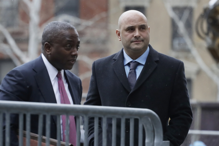 Craig Carton, right, the former co-host of a sports radio show with ex-NFL quarterback Boomer Esiason, arrives at federal court to be sentenced for defrauding investors in a ticket reselling business, Friday, April 5, 2019, in New York. (AP Photo/Mark Lennihan)
