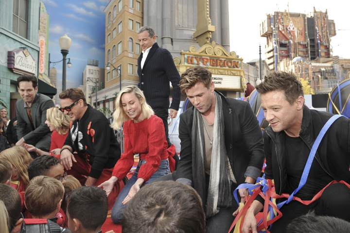 """Avengers: Endgame"" cast member, Paul Rudd, foreground from left, Scarlett Johansson, Robert Downey Jr., Brie Larson, Chris Hemsworth and Jeremy Renner appear with Disney CEO, Robert Iger,, background center, at an event announcing the Universe Unites Charity at Disney California Adventure Park on Friday, April 5, 2019, in Anaheim, Calif. (Photo by Richard Shotwell/Invision/AP)"