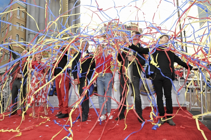 """""""Avengers: Endgame"""" cast members, Paul Rudd, from left, Scarlett Johansson, Robert Downey Jr., Robert Iger, Brie Larson, Chris Hemsworth and Jeremy Renner release streamers as they announce the Universe Unites Charity at Disney California Adventure Park on Friday, April 5, 2019, in Anaheim, Calif. (Photo by Richard Shotwell/Invision/AP)"""