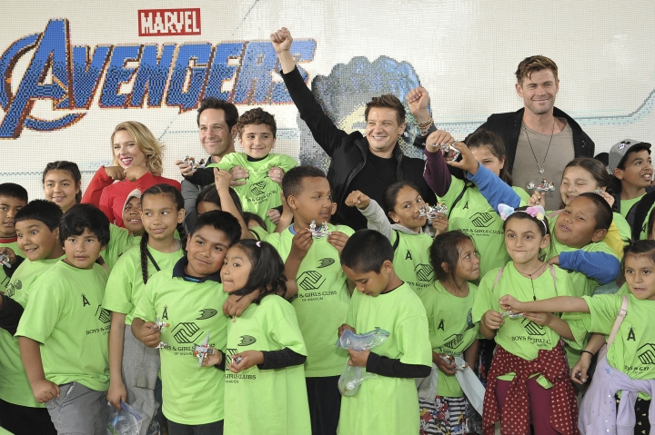 """Actors Scarlett Johansson, background from left, Paul Rudd, Jeremy Renner and Chris Hemsworth, from the upcoming film """"Avengers: Endgame"""" appear with kids at an event promoting the Universe Unites Charity at Disney California Adventure Park on Friday, April 5, 2019, in Anaheim, Calif. (Photo by Richard Shotwell/Invision/AP)"""