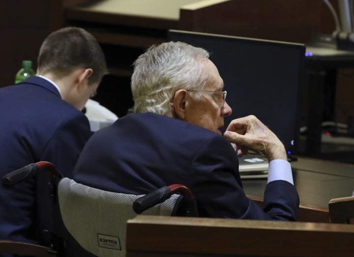 Former U.S. senator Harry Reid listens as Dr. Farheen Khan, director, Human Factor Division Rimkus Consulting Group, not photographed, during his civil trial, at the Regional Justice Center on Friday, April 5, 2019, in Las Vegas. Reid sued the makers of an exercise band after injuring his eye. (Bizuayehu Tesfaye/Las Vegas Review-Journal via AP)