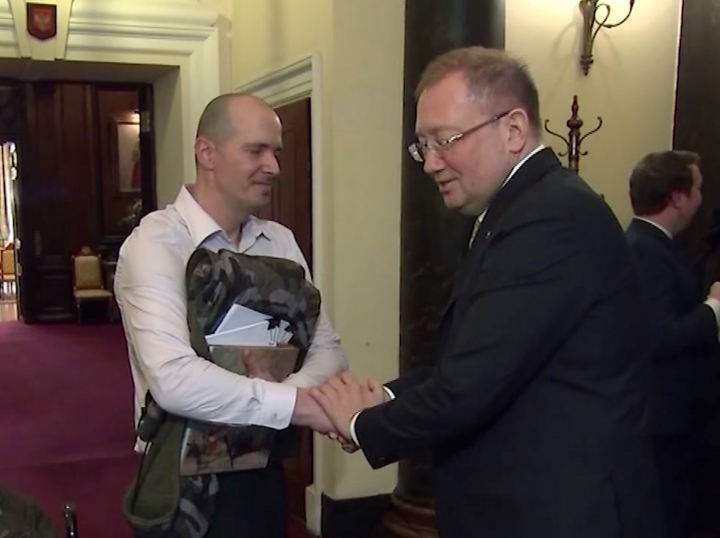 Russian Ambassador to the UK Alexander Yakovenko, right, shakes hands with Novichok poisoning victim Charlie Rowley, inside the Russian Embassy in London, where they met for talks Saturday April 6, 2019. UK citizen Charlkie Rowley, who was exposed to the deadly Novichok nerve agent in June 2018 in Amesbury, England, near Salisbury the city where Russian former spy Sergei Skripal and his daughter were poisoned with Novichok, visited the Russian Embassy in London to seek answers to their questions about the notorious poisoning. Rowley survived the poisoning, though still suffers various health problems, but his partner Dawn Sturgess died. (RTR via AP)