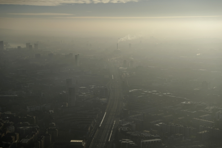 FILE - In this Thursday, Jan. 19, 2017 file photo pollution haze over South East London, through a window in a viewing area of the 95-storey skyscraper The Shard, the tallest building in Britain, in London. The world's first emission charge for cars come into force in London Monday April 8, 2019 with drivers of older and more polluting cars face paying a new £12.50 fee adding to the Congestion Charge to enter the centre of the capital.(AP Photo/Matt Dunham, File)