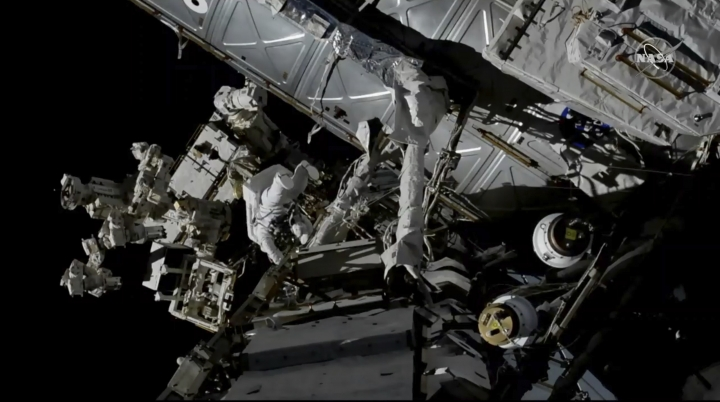 In this photo provided by NASA, Canadian astronaut David Saint-Jacques, center left, works outside the International Space Station, Monday, April 8, 2019. Saint-Jacques and NASA astronaut Anne McClain got an early start Monday morning as they tackled battery and cable work outside the International Space Station. It's the third spacewalk in just 2 ½ weeks for the station crew. (NASA via AP)