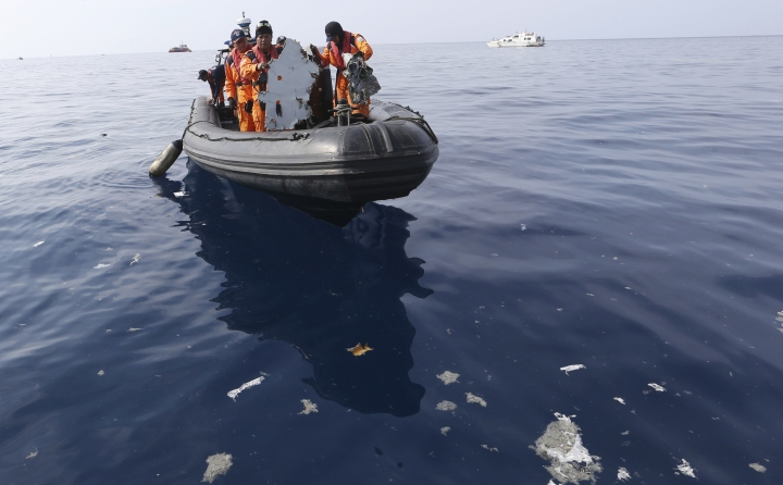 In this Oct 29, 2018, photo, rescuers recover a piece of airplane part from Lion Air flight 610 that crashed into the sea during a rescue operation in the waters of Tanjung Karawang, Indonesia. More families of victims of the Lion Air crash in Indonesia are suing Boeing Co. after its chief executive apologized last week and said a software update for the MAX 8 jet would prevent further disasters. (AP Photo/Achmad Ibrahim)