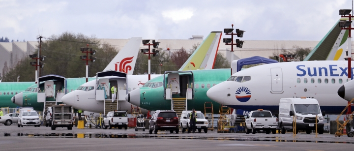 Boeing 737 Max model aircraft are parked at the airport adjacent to a Boeing Co. production facility, Monday, April 8, 2019, in Renton, Wash. Boeing said the week before that it will cut production of its troubled 737 Max airliner in April, underscoring the growing financial risk it faces the longer that its best-selling plane remains grounded after two crashes. (AP Photo/Elaine Thompson)
