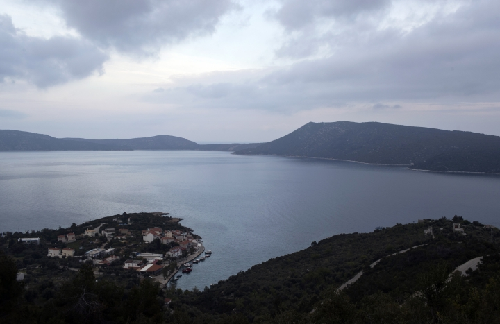 This photo taken on Friday, April 5, 2019 shows the harbor of Steni Vala with the island of Peristera on the background, in Greece. Off the coast of Peristera is a 5th Century B.C. shipwreck, the first ancient shipwreck to be opened to the public in Greece, including to recreational divers who will be able to visit the wreck itself. Greece's rich underwater heritage has long been hidden from view, off-limits to all but a select few, mainly archaeologists. Scuba diving was banned throughout the country except in a few specific locations until 2005, for fear that divers might loot the countless antiquities that still lie scattered on the country's seabed. Now that seems to be gradually changing, with a new project to create underwater museums. (AP Photo/Elena Becatoros)