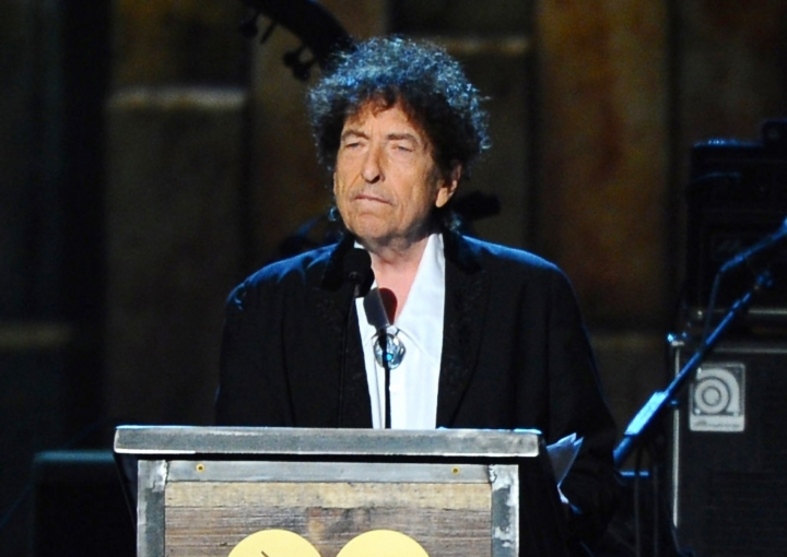 """FILE - In this Feb. 6, 2015 file photo, Bob Dylan accepts the 2015 MusiCares Person of the Year award at the 2015 MusiCares Person of the Year show in Los Angeles. Dylan is set to help open a whiskey distillery in fall 2020 under the brand """"Heaven's Door."""" (Photo by Vince Bucci/Invision/AP, File)"""