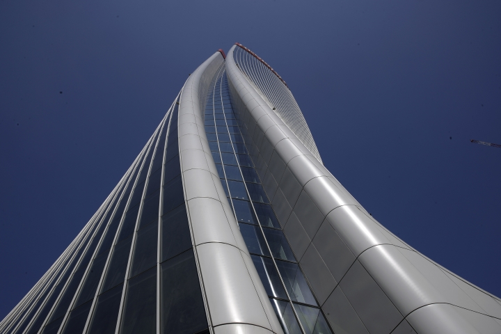 A view of the Generali tower skyscraper, designed by architect and designer Zaha Hadid, which was officially inaugurated in Milan, Italy, Tuesday, April 9, 2019. (AP Photo/Luca Bruno)