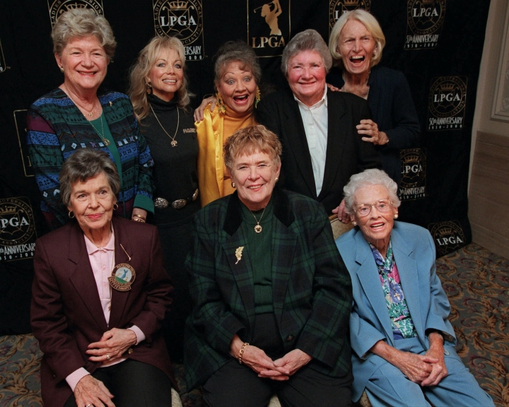 FILE - In this Oct. 19, 1999, file photo, eight founders of the Ladies Professional Golf Association (LPGA) pose at a celebration of the association's 50th anniversary in New York. Back row from left are Marilynn Smith, Marlene Hagge, Alice Bauer, Louise Suggs and Betty Jameson. Front row from left are Bettye Sanoff, Shirley Spork and Patty Berg. Marilynn Smith died Tuesday, April 9, 2019. She was 89.(AP Photo/Stuart Ramson, File)