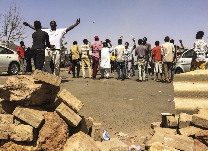 Protesters are searched as they enter a demonstration near the military headquarters, Tuesday, April 9, 2019, in the capital Khartoum, Sudan. Activists behind anti-government protests in Sudan say security forces have killed at least seven people, including a military officer, in another attempt to break up the sit-in outside the military headquarters in Khartoum. A spokeswoman for the Sudanese Professionals Association, said clashes erupted again early Tuesday between security forces and protesters who have been camping out in front of the complex in Khartoum since Saturday. (AP Photo)
