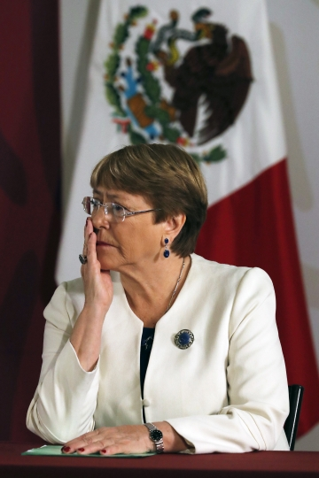 Michelle Bachelet, United Nations High Commissioner for Human Rights, attends a signing ceremony at the National Palace in Mexico City, Tuesday, April 9, 2019. Mexico's efforts to calm critics of its newly formed National Guard have received a boost in the form of an agreement with Bachelet who said that her office will offer technical assistance to ensure that Mexico's new security force respects human rights. (AP Photo/Marco Ugarte)