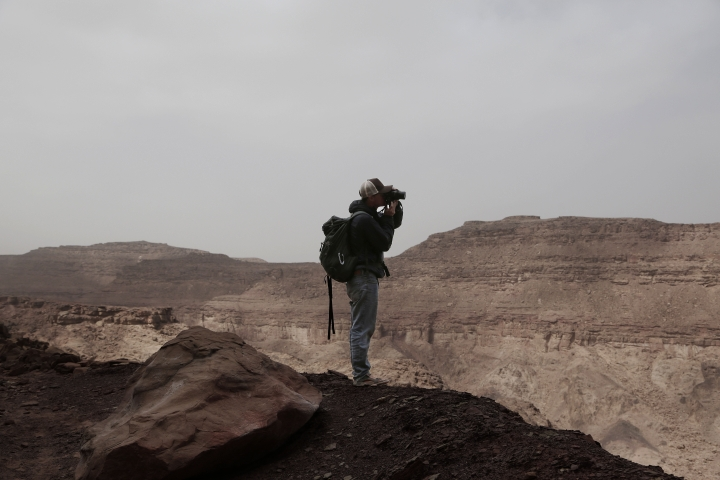 In this March 30, 2019 photo, Ben Hoffler, co-founder of the Sinai Trail, takes photographs on a trek in the mountains, near Wadi Sahw, Abu Zenima, in South Sinai, Egypt. Until now, all the project's guides were men. Ben Hoffler, the British co-founder of the Sinai Trail, felt it was not enough. But even after years of trying by Hoffler, almost all the tribes still reject women guides. Only one of the smallest, oldest and poorest tribes, the Hamada, accepted the idea. (AP Photo/Nariman El-Mofty)