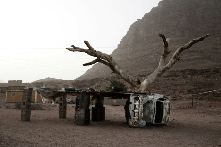 In this March 30, 2019 photo, shows remains of a car used to as a base for shelter in Wadi Sahw, Abu Zenima, in South Sinai, Egypt. Four Bedouin women are for the first time leading tours in Egypt's Sinai Peninsula, breaking new ground in their deeply conservative community, where women almost never work outside the home or interact with outsiders. The tourists can only be women, and the tours can't go overnight. Each day before the sun sets, the group returns to the Hamada's home village in Wadi Sahu, a narrow desert valley. (AP Photo/Nariman El-Mofty) (AP Photo/Nariman El-Mofty)