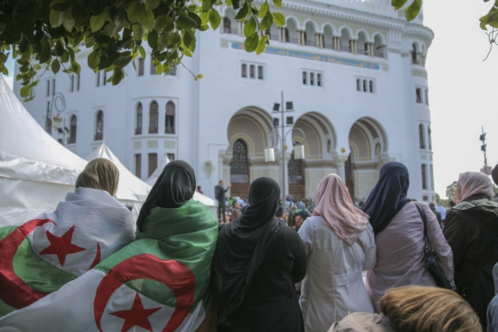 Women observe and chant slogans during a demonstration in Algiers, Algeria, Wednesday, April 10, 2019. Thousands took to the streets rejecting the country's interim leader Abdelkader Bensalah, an ally of former President Abdelaziz Bouteflika. (AP Photo/Mosa'ab Elshamy)