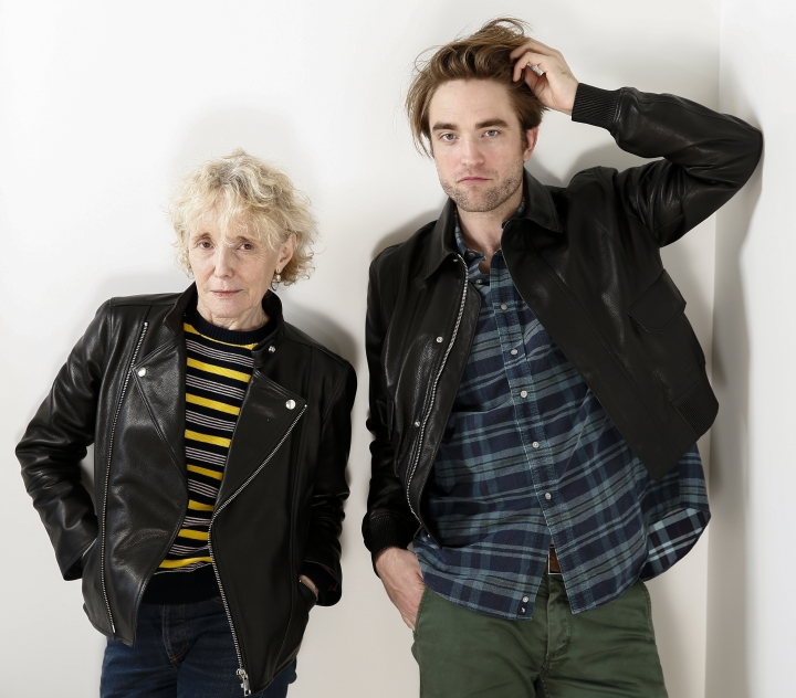 "This April 4, 2019 photo shows filmmaker Claire Denis, left, and actor Robert Pattinson posing for a portrait to promote their film, ""High Life"" in New York. (Photo by Brian Ach/Invision/AP)"