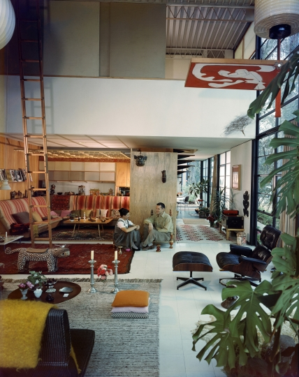 This 1958 photo by renowned architectural photographer Julius Shulman shows Ray and Charles Eames in the living room of their home, filled with objects, textiles and artwork in what has become known as Eames House in The Pacific Palisades area of Los Angeles. The Getty Conservation Institute has announced plans to restore and maintain the Eames House, one of Los Angeles' most stunning homes for generations to come. The institute said Wednesday, April 10, 2019, it partnered with the Eames Foundation on an ambitious conservation plan for the home. (Julius Shulman/J. Paul Getty Trust via AP)