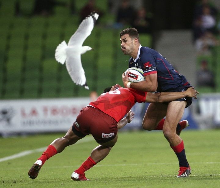 Tom English of the Rebels, right, is tackled by Ryohei Yamanaka of the Sunwolves during their Super Rugby match in Melbourne, Australia, Saturday, April 6, 2019. (Hamish Blair/AAP Image via AP)