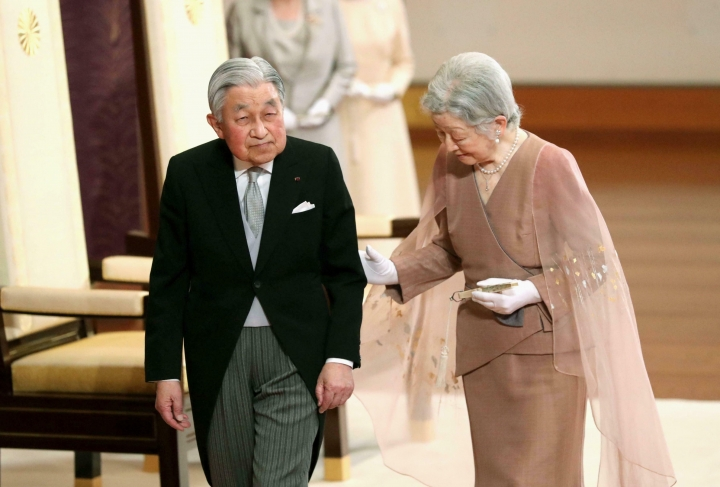 Japan's Emperor Akihito, left, and Empress Michiko, right, leave after the celebration ceremony of their 60th wedding anniversary at the Imperial Palace in Tokyo, Wednesday, April 10, 2019. (Kyodo News via AP)