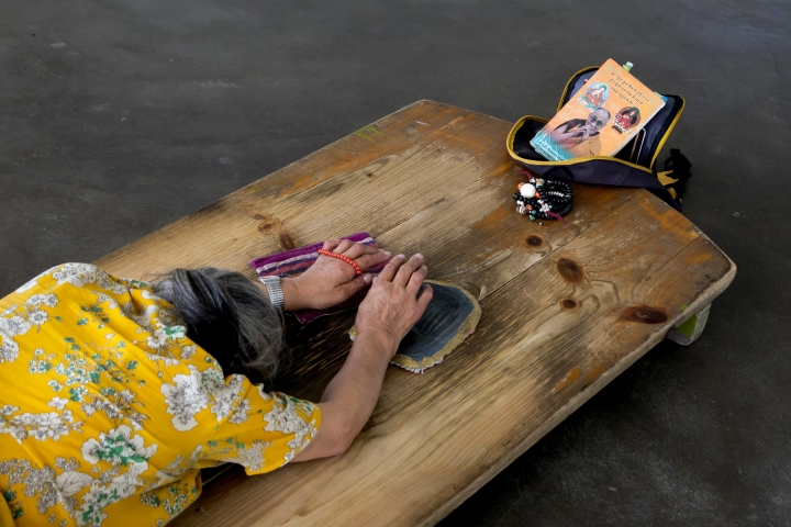 An exile Tibetan woman prays as she prostrates in front of a portrait of her spiritual leader the Dalai Lama in Dharmsala, India, Wednesday, April 10, 2019. The Dalai Lama has been hospitalised in the Indian capital with chest infection and is feeling much better. The Tibetan spiritual leader's spokesman Tenzin Taklha says the Dalai Lama is under medication and likely to spend a day or two in the hospital. The Dalai Lama flew to New Delhi from Dharmsala for consultations with doctors and was hospitaliszd on Tuesday, April 9, 2019. (AP Photo/Ashwini Bhatia)