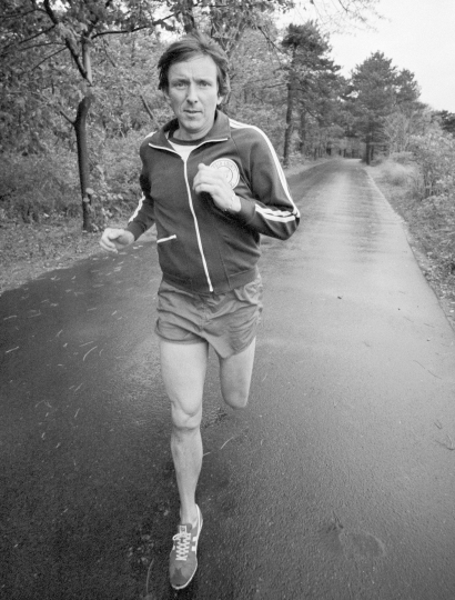 FILE - In this November 1977 file photo, marathoner Jim Fixx runs on a road near his home in Connecticut. In July 1984, the acclaimed author and running guru died of a massive heart attack while trotting along a country road in Vermont. Boston Marathon race director Dave McGillivray is cautioning people thinking of running a marathon to talk with their doctors before hitting the road, especially if they have coronary artery disease or a family history of it. (AP Photo/Jerry Mosey, File)