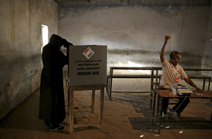 An Indian Muslim woman casts her vote at a polling station in village Sawaal near Meerut, Uttar Pradesh, India, Thursday, April 11, 2019. Voters in 18 Indian states and two Union Territories began casting ballots on Thursday, the first day of a seven-phase election staggered over six weeks in the country of 1.3 billion people. The election, the world's largest democratic exercise, is seen as a referendum on Prime Minister Narendra Modi and his Bharatiya Janata Party. (AP Photo/Altaf Qadri)