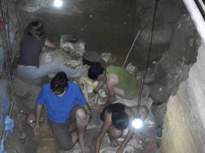 In this June 30, 2015, handout photo provided by Eusebio Dizon, foreign and Filipino archeologists work inside Callao cave in Cagayan province, northern Philippines where they recovered fossil bones and teeth belonging to a new human species they called Homo Luzonensis. Archaeologists who discovered fossil bones and teeth of a previously unknown human species that thrived more than 50,000 years ago in the northern Philippines say they plan more diggings and better protection of the popular limestone cave complex where the remains were unearthed. (Eusebio Dizon via AP)