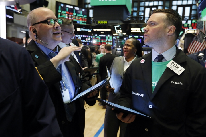 Traders Jeffrey Vazquez, left, and Frank Masiello confer on the floor of the New York Stock Exchange, Thursday, April 11, 2019. U.S. stocks moved slightly higher in morning trading Thursday as investors prepare for the latest round of corporate earnings. (AP Photo/Richard Drew)