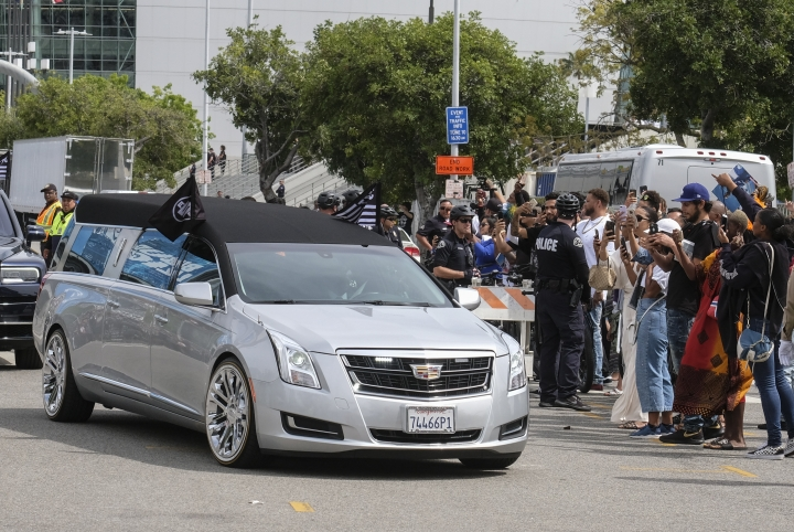 The hearse carrying rapper Nipsey Hussle leaves the Staples Center after a memorial service in Los Angeles, Thursday, April 11, 2019. Hussle was killed in a shooting outside his Marathon Clothing store in south Los Angeles on March 31. (AP Photo/Ringo H.W. Chiu)