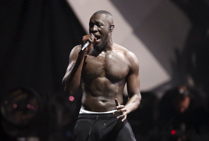 FILE - In this file photo dated Wednesday, Feb. 21, 2018, British grime artist Stormzy performs at the Brit Awards 2018 in London. The Austrian music Snowbombing festival in Mayrhofen, Austria, is apologizing to Stormzy, who pulled out of an appearance on Wednesday April 10, 2019, after accusing security staff of racial profiling. (Photo by Joel C Ryan/Invision/AP, file)