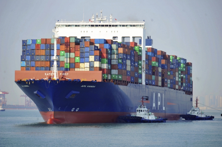 In this April 1, 2019, photo, tugboats move a container ship at a port in Qingdao in eastern China's Shandong Province. Data released Friday, April 12, 2019, shows that China's exports rebounded from a contraction in March and sales to the United States grew strongly despite President Donald Trump's tariff hikes.(Chinatopix via AP)