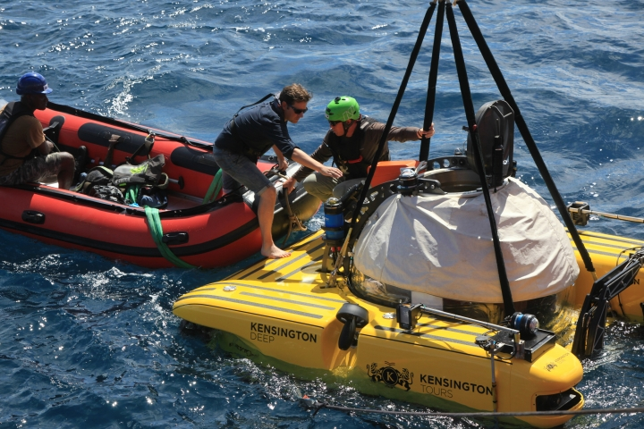 Associated Press reporter, David Keyton, boards a submersible off the coast of the island of St. Joseph in the Seychelles, Monday April 8, 2019. Able to operate down to 1,000 feet, the manned submersible gives scientists a unique understanding of changes in habitats as sunlight diminishes through the different layers of ocean. (AP Photo/Steve Barker)