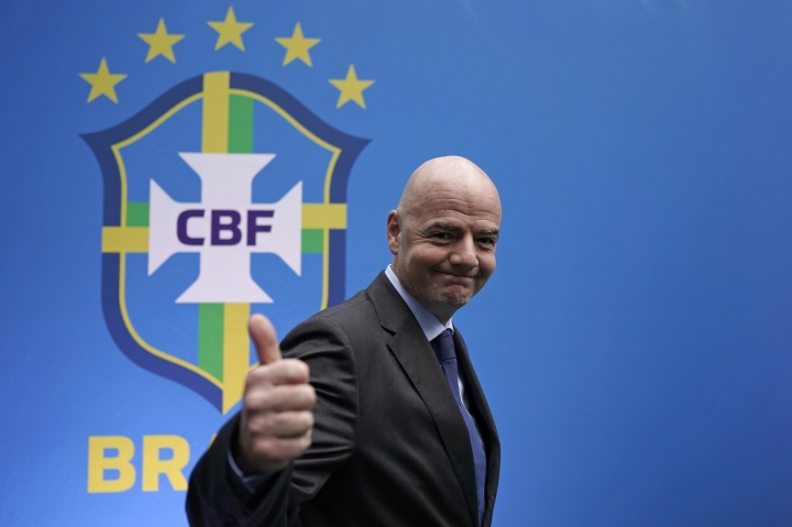 FIFA President Gianni Infantino gives a thumbs up after speaking to the press at the swearing-in ceremony of Rogerio Caboclo as president of the Brazilian Football Confederation in Rio de Janeiro, Brazil, Tuesday, April 9, 2019. The biggest challenges for Caboclo will be ending Brazil's World Cup title drought, dating back to 2002, improving the country's youth teams and moving the national governing body away from scandal. (AP Photo/Leo Correa)