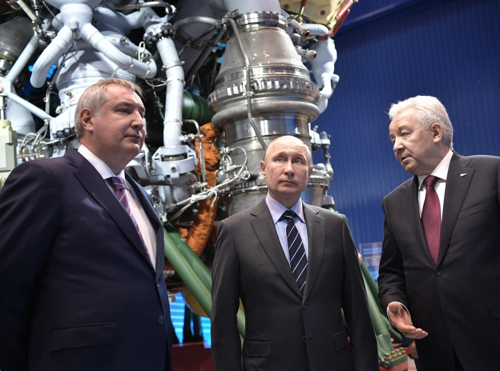 President Vladimir Putin, center, talks with Russian Roscosmos head Dmitry Rogozin, left, and the Energomash Director General Igor Arbuzov as he visits the the Energomash, leading Russian rocket engine company, in Luhansk, Russia, Friday, April 12, 2019. Putin visited the factory on the Cosmonauts Day, a holiday marking Yuri Gagarin's pioneering flight to space, to promise that the government would earmark funds to develop new rocket technologies. (Alexei Nikolsky, Sputnik, Kremlin Pool Photo via AP)