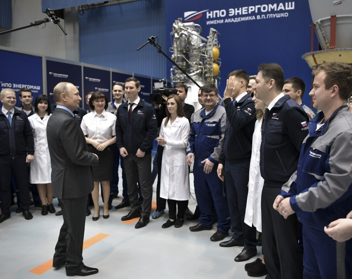 President Vladimir Putin, left, speaks to employees at the the Energomash, leading Russian rocket engine company, in Moscow, Russia, Friday, April 12, 2019. Putin visited the factory on the Cosmonauts Day, a holiday marking Yuri Gagarin's pioneering flight to space, to promise that the government would earmark funds to develop new rocket technologies. (Alexei Nikolsky, Sputnik, Kremlin Pool Photo via AP)