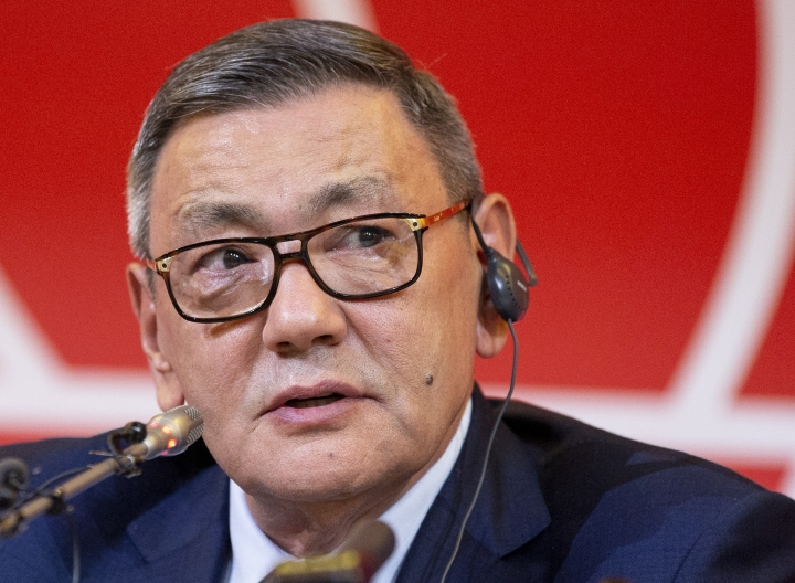 FILE - In this Saturday, Nov. 3, 2018 file photo, president of the amateur boxing federation Gafur Rakhimov speaks to the media upon becoming the head of AIBA in Moscow, Russia. The International Boxing Association has as few as six weeks left to save the sport's place at the 2020 Olympics. Now its new interim president has arrived in the IOC's home city Lausanne for the final rounds of lobbying. Mohamed Moustahsane is a long-time ringside doctor from Morocco, who praised his predecessor whose alleged links to organized crime helped provoke the crisis in Olympic boxing. (AP Photo/Alexander Zemlianichenko, file)