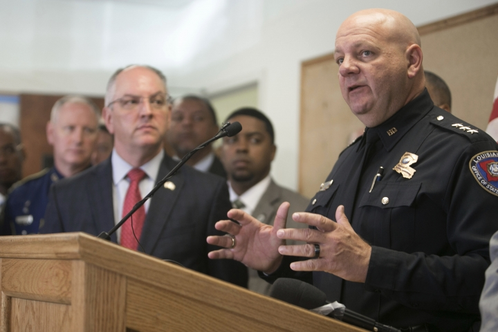 "Louisiana State Fire Marshal H. ""Butch"" Browning speaks as Louisiana Gov. John Bel Edwards looks on during a press conference on the arrest of a suspect Holden Matthews for the arson of three churches in Opelousas, La., Thursday, April 11, 2019. (AP Photo/Lee Celano)"