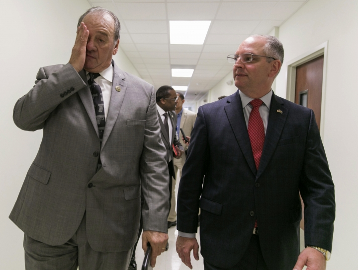 St. Landry Parish Sheriff Bobby Guidroz rubs his face as Louisiana Gov. John Bel Edwards looks on following a press conference on the arrest of a suspect Holden Matthews for the arson of three churches in Opelousas, La., Thursday, April 11, 2019. (AP Photo/Lee Celano)