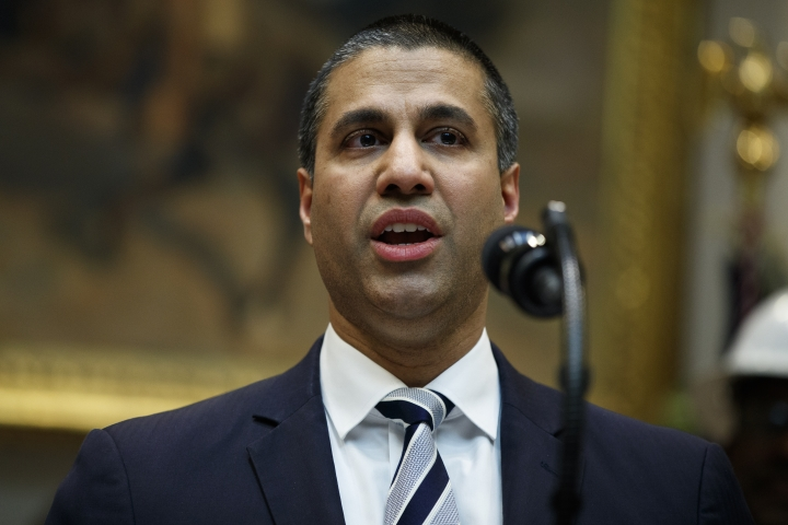FCC chairman Ajit Pai speaks during an event with President Donald Trump on the deployment of 5G technology in the United States, in the Roosevelt Room of the White House, Friday, April 12, 2019, in Washington. (AP Photo/Evan Vucci)