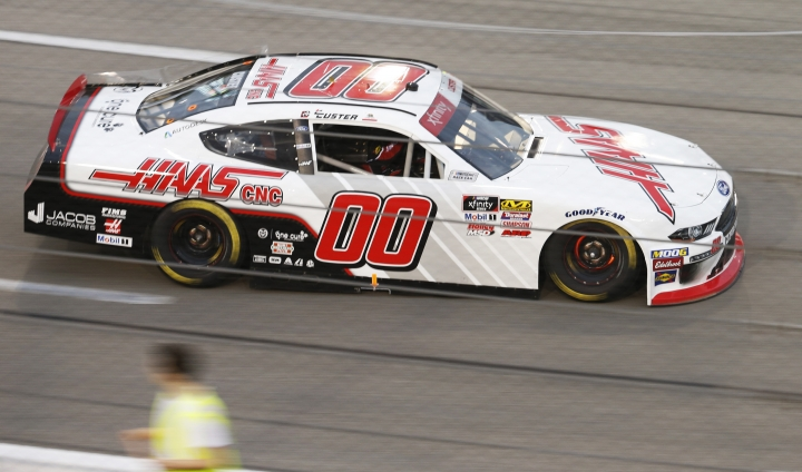 Cole Custer heads into Turn 1 during the NASCAR Xfinity Series auto race at Richmond Raceway in Richmond, Va., Friday, April 12, 2019. (AP Photo/Steve Helber)
